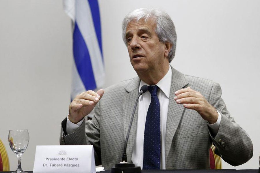 Newly elected Uruguayan President Tabare Vazquez gestures while announcing the ministers of his government at his office in Montevideo December 2, 2014. Reuters.