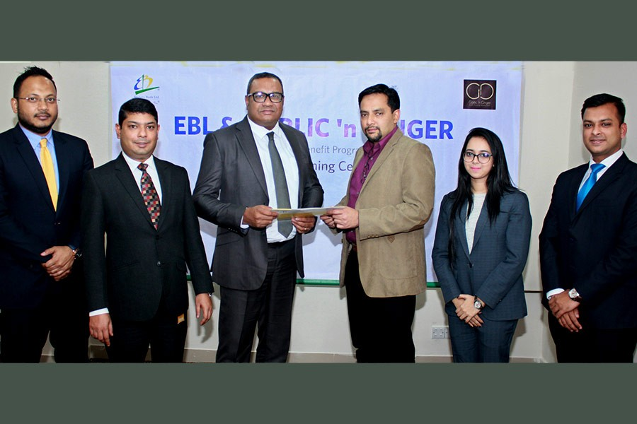 EBL's Head of Retail Banking M. Khorshed Anowar and SR Group CEO Md. Mahtabul Amin exchanging documents after signing a customer benefit agreement in Dhaka.