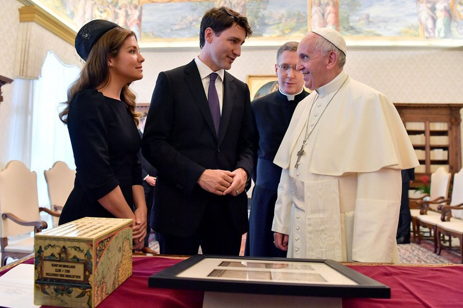 Pope Francis exchanges gifts with Canada's Prime Minister Justin Trudeau and his wife Sophie Gregoire Trudeau during a private audience at the Vatican. Reuters.