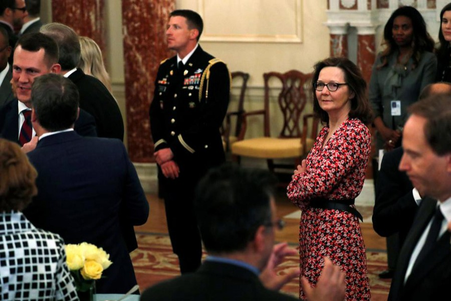US Central Intelligence Agency (CIA) director nominee Gina Haspel (C) attends Secretary of State Mike Pompeo's ceremonial swearing-in at the State Department in Washington, May 2, 2018. Reuters