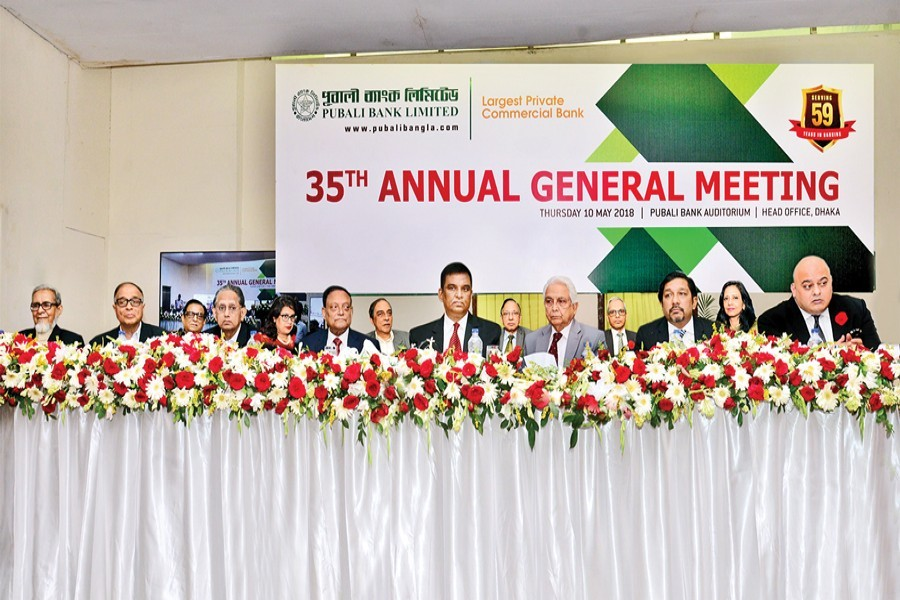 Chairman of Pubali Bank Limited Habibur Rahman presiding over the 35th annual general meeting of the bank held at the bank's auditorium on Thursday