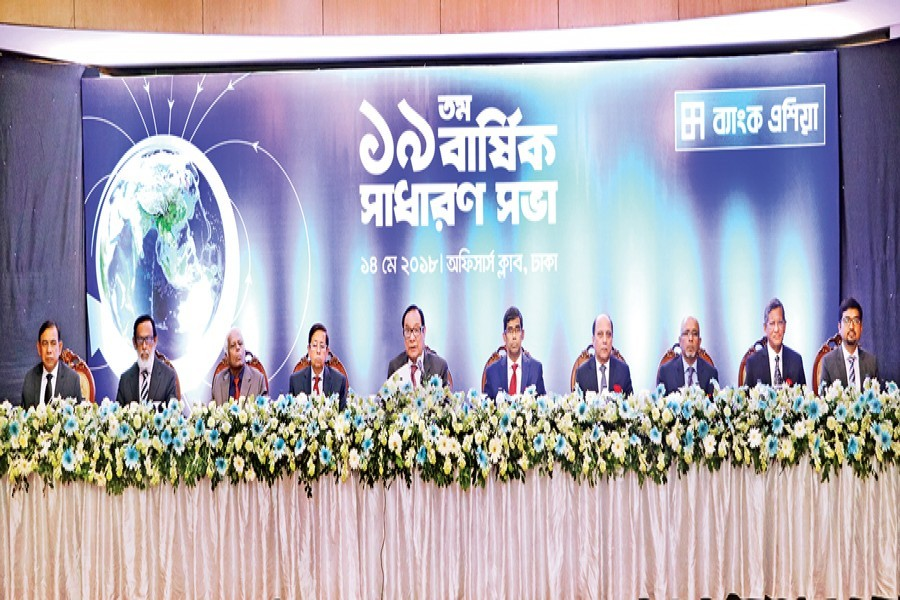 Chairman of Bank Asia A. Rouf Chowdhury presiding over the 19th annual general meeting of the bank at the Dhaka Officers Club in the city on Monday