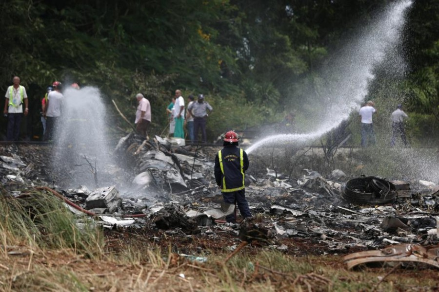 Firefighters work in the wreckage of a Boeing 737 plane that crashed in the agricultural area of Boyeros, around 20 km (12 miles) south of Havana, shortly after taking off from Havana's main airport in Cuba, May 18, 2018. Reuters.