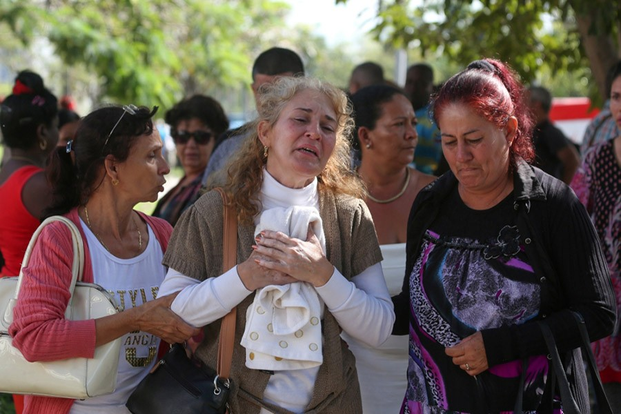 Relatives of victims of the Boeing 737 plane that crashed after taking off from Havana's main airport on Friday, react as they leave the Legal Medical Institute in Havana, Cuba on Saturday - Reuters photo