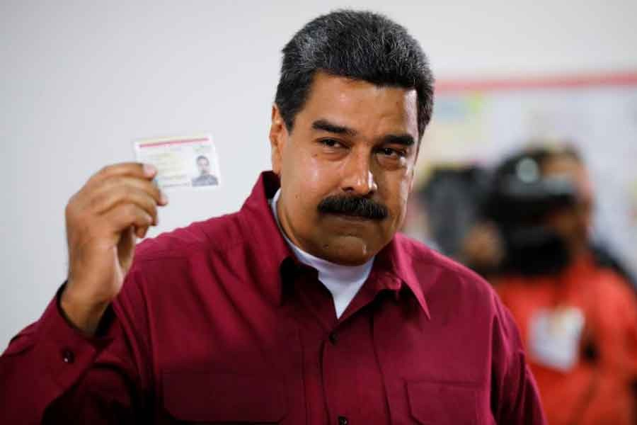 Venezuela's President Nicolas Maduro casts his vote at a polling station, during the presidential election in Caracas, Venezuela May 20, 2018. Reuters.