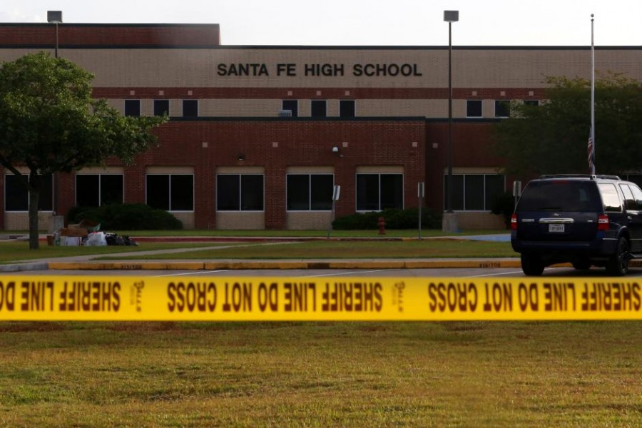 Police tape is seen near the site of the shooting at the Santa Fe High School in Santa Fe, Texas, US, May 20, 2018. Reuters.