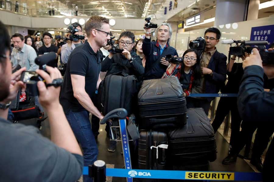 CNN's Will Ripley arrives at Beijing aiport to board a plane to North Korea in Beijing, China, May 22, 2018. Reuters
