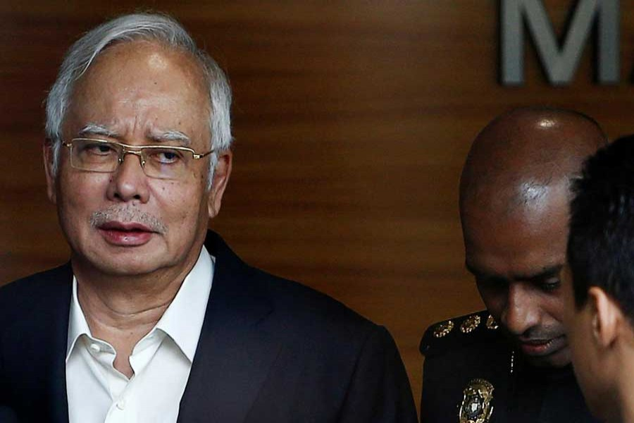Malaysia's former prime minister Najib Razak arrives to give a statement to the Malaysian Anti-Corruption Commission (MACC) in Putrajaya, Malaysia May 24, 2018. Reuters