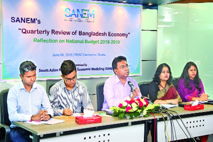 Dr Selim Raihan, executive director of SANEM, speaking at a press conference in the capital on Saturday