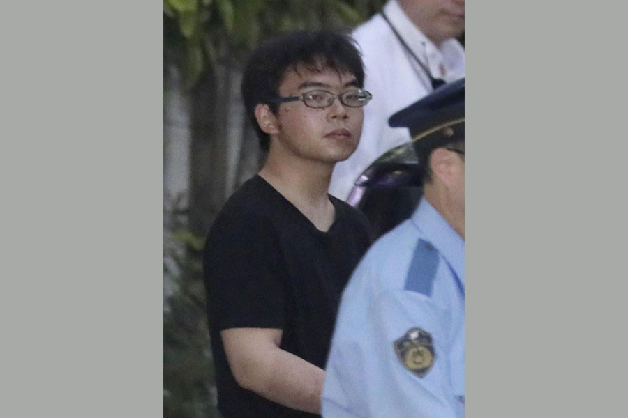 Ichiro Kojima, 22, a suspect in a stabbing incident inside a Japanese Shinkansen bullet train, leaves Odawara police station after being arrested in Odawawa, west of Tokyo, Japan, in this photo taken by Kyodo June 10, 2018. Reuters.