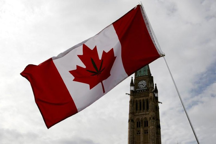A Canadian flag with a marijuana leaf on it is seen during the annual 4/20 marijuana rally on Parliament Hill in Ottawa, Ontario, Canada, April 20, 2017. Reuters.
