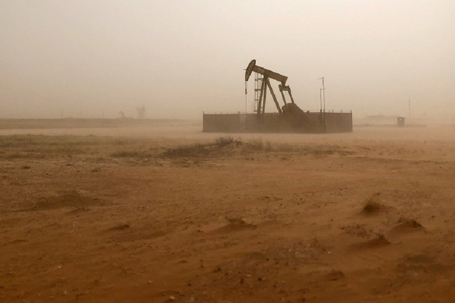 A pump jack lifts oil out of a well, during a sandstorm in Midland, Texas, US, April 13, 2018. Reuters/File Photo