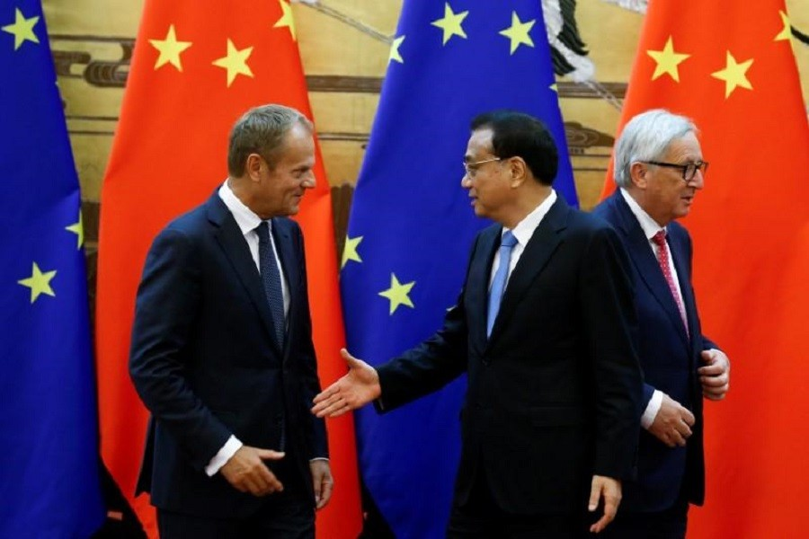 European Council President Donald Tusk, Chinese Premier Li Keqiang and European Commission President Jean-Claude Juncker attend a news conference at the Great Hall of the People in Beijing, China, July 16, 2018. Reuters