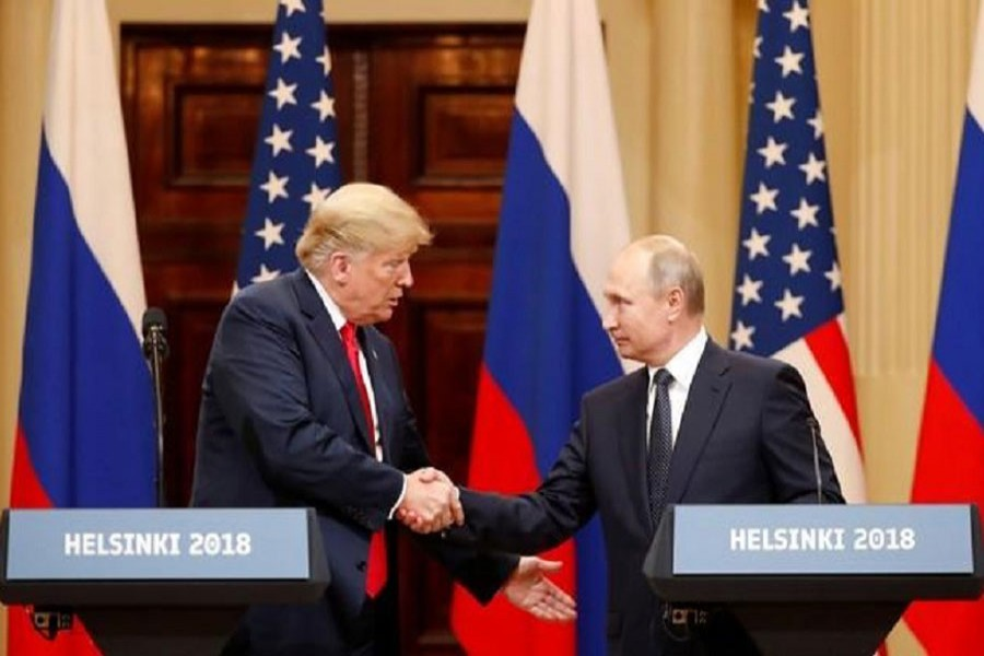 US President Donald Trump and Russian President Vladimir Putin shake hands as they hold a joint news conference after their meeting in Helsinki, Finland July 16, 2018. Reuters