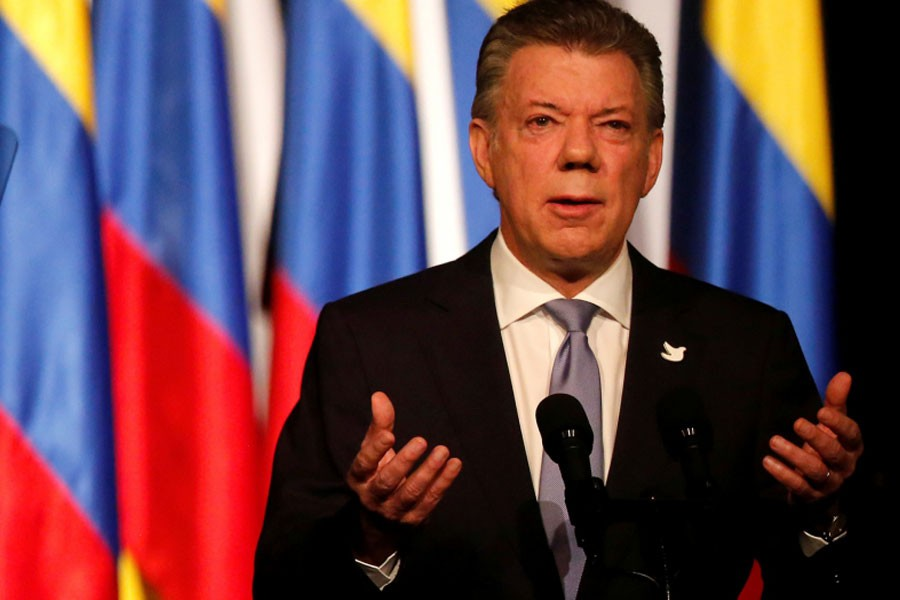 Colombia's President Juan Manuel Santos gives his speech after signing a new peace accord with Marxist FARC rebel leader Rodrigo Londono, known as Timochenko, in Bogota, Colombia, November 24, 2016 – Reuters photo