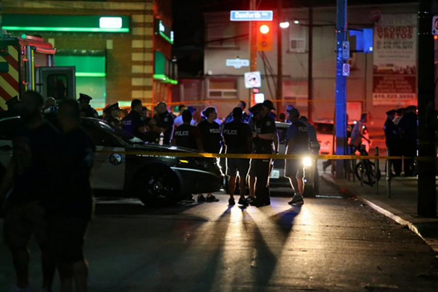 Police are seen near the scene of a mass shooting in Toronto, Canada on Sunday — Reuters photo