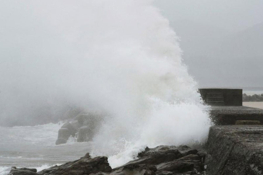 A wave, caused by Typhoon Noru, splashes the coast in Kushima, Miyazaki prefecture, Japan, August 6, 2017 in this photo taken by Kyodo – Reuters
