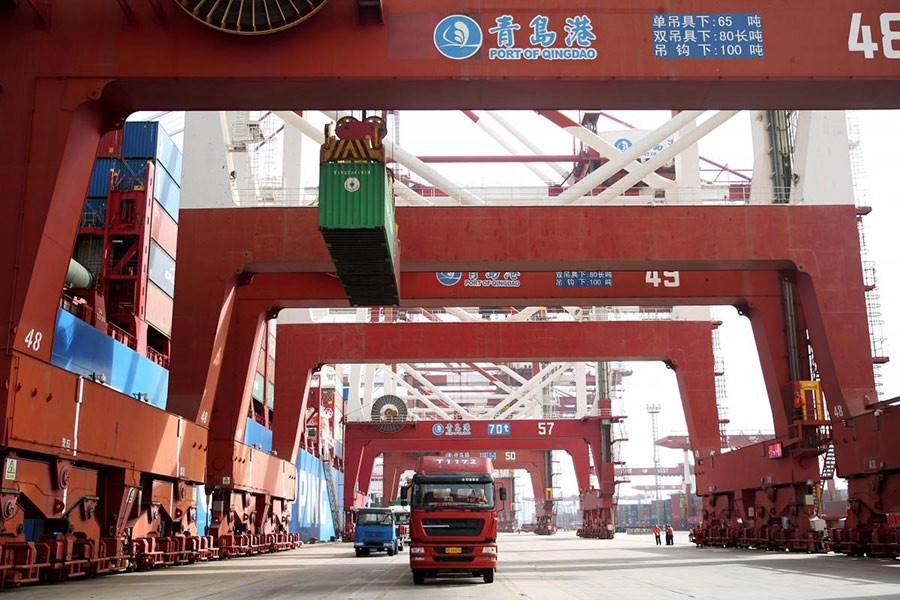 Trucks transport containers at a port in Qingdao, Shandong province in China on April 8 last — Reuters/File