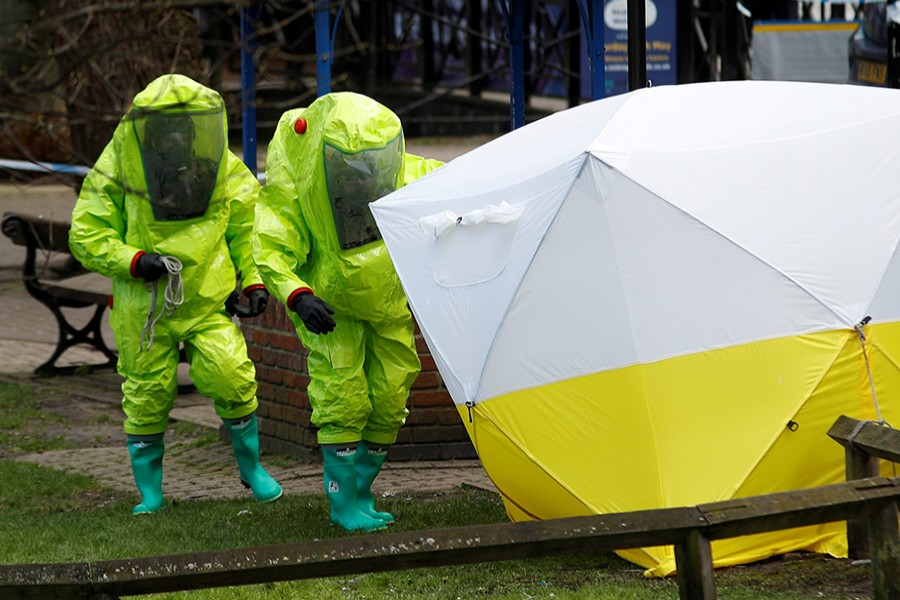 The forensic tent, covering the bench where Sergei Skripal and his daughter Yulia were found, is repositioned by officials in protective suits in the center of Salisbury, Britain — Reuters/File