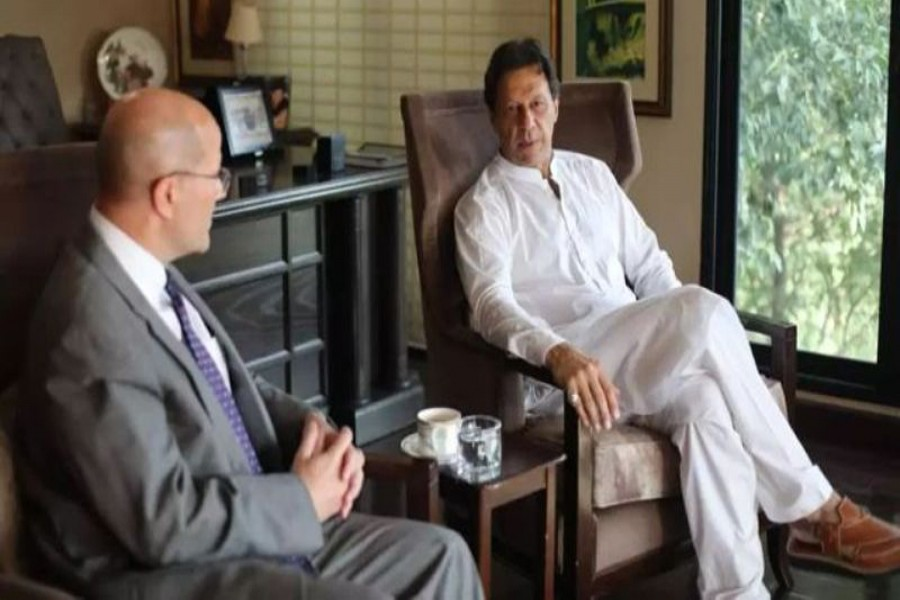 Pakistani prime minister-in-waiting Imran Khan holding talks with acting US Ambassador in Pakistan John F Hoover in Islamabad on Wednesday— AFP