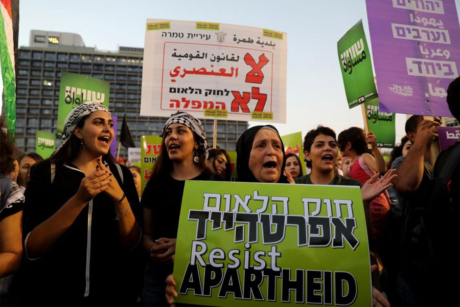 Israeli Arabs and their supporters take part in a rally to protest against Jewish nation-state law in Rabin square in Tel Aviv, Israel August 11, 2018 – Reuters