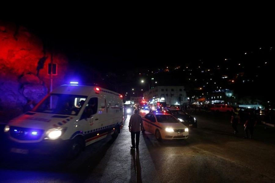 An ambulance and a Jordanian police car is seen one day after the security incident, at the city of Al Salt, Jordan on Saturday — Reuters