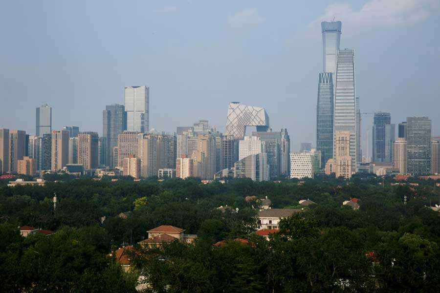 The skyscrapers of the Central Business District rise behind the capital's embassy neighbourhood in Beijing, China, July 28, 2018. Reuters/Files