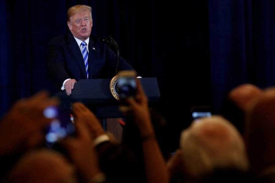 US President Donald Trump delivers remarks during a meeting with supporters in Utica, New York, US, August 13, 2018. Reuters