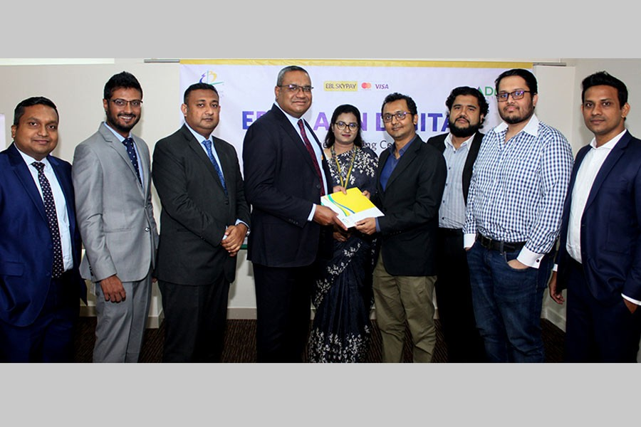 EBL Head of Retail Banking M. Khorshed Anowar and ADN Group Chief of Digital Business and Marketing Ruhullah Raihan Alhusain exchanging documents after signing an agreement at EBL's head office in Dhaka recently.