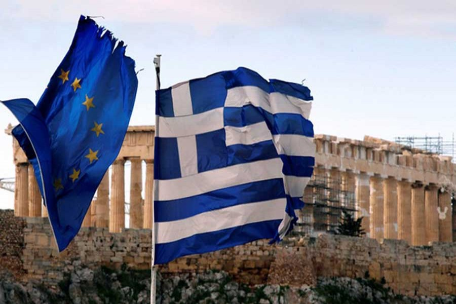 The Parthenon on the Athens Acropolis is seen behind a Greek and an EU flag atop the Greek ministry of finance Feb 8, 2012. Greek parties will try again on Wednesday to agree a reform deal in return for a new international rescue to avoid a chaotic default, after delays prompted some EU leaders to warn that the euro zone can live without Athens. Reuters/Files