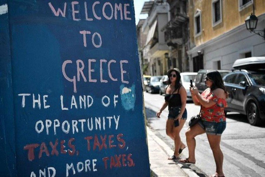 Greek PM heads to Odysseus' home at end of bailout journey