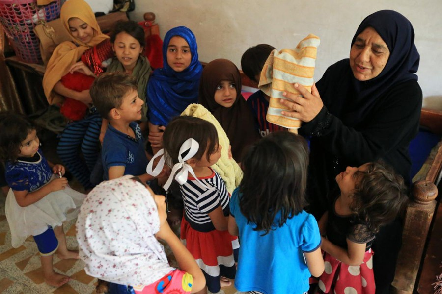 After IS killed her sons, Iraqi grandmother fends for 22 children