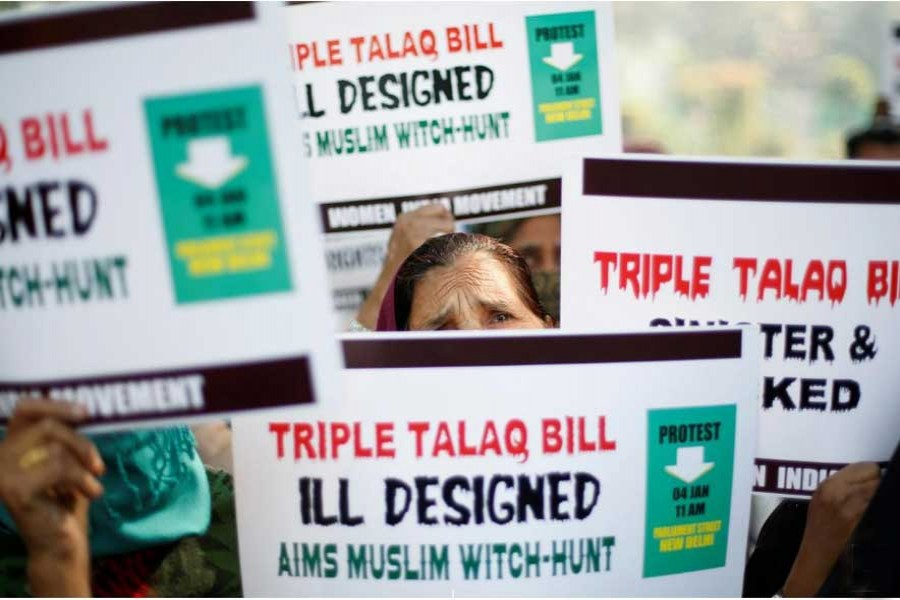 """Muslim women hold placards during a protest against a bill passed by India's lower house of Parliament last week that aims at prosecuting Muslim men who divorce their wives through the """"triple talaq,"""" or instant divorce, in New Delhi, India Jan 4, 2018.  - Reuters"""