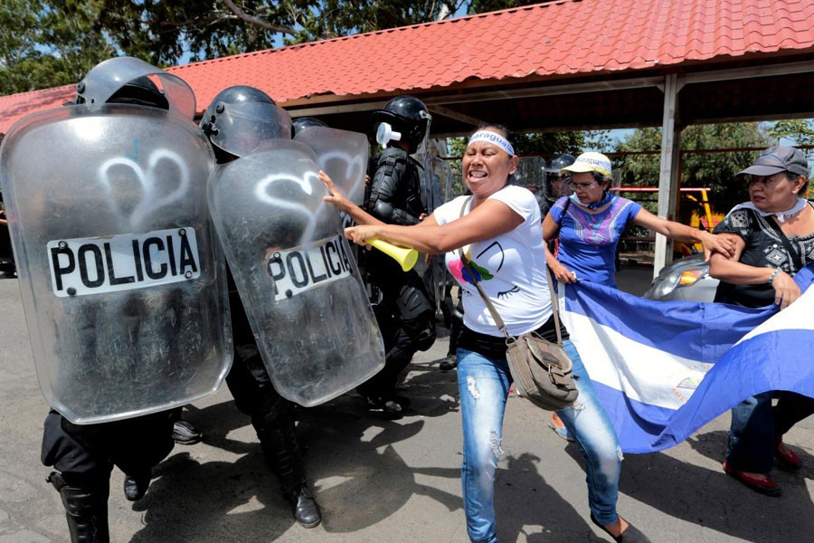 A demonstrator clashes with riot police during a protest against Nicaraguan President Daniel Ortega's government in Managua, Nicaragua September 23, 2018 – Reuters