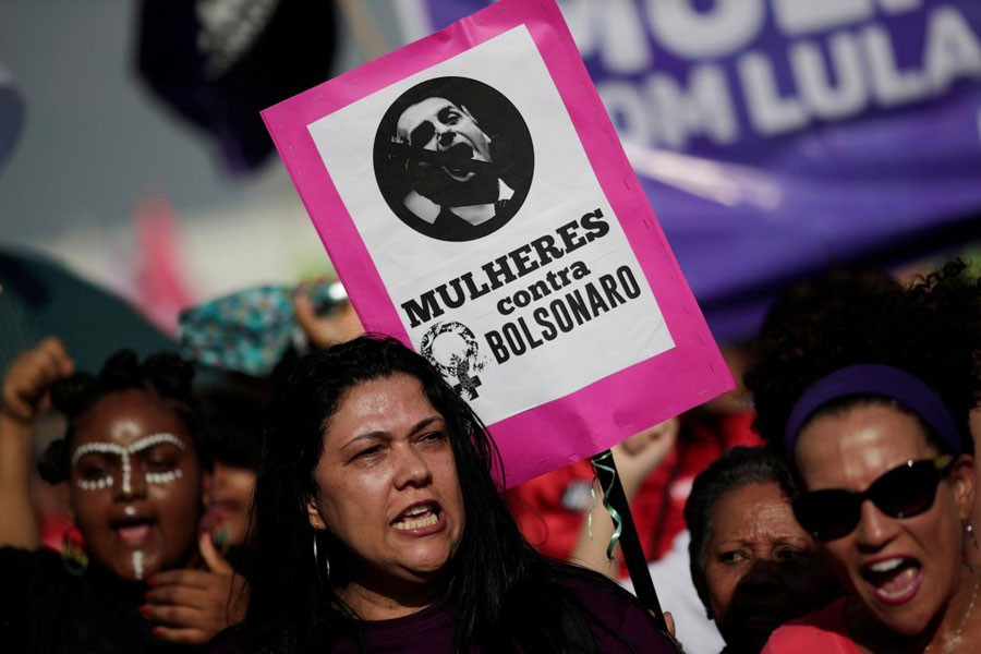 """A woman holds a sign that reads """"Women against Bolsonaro"""" during demonstrations against presidential candidate Jair Bolsonaro in Brasilia, Brazil September 29, 2018 – Reuters"""