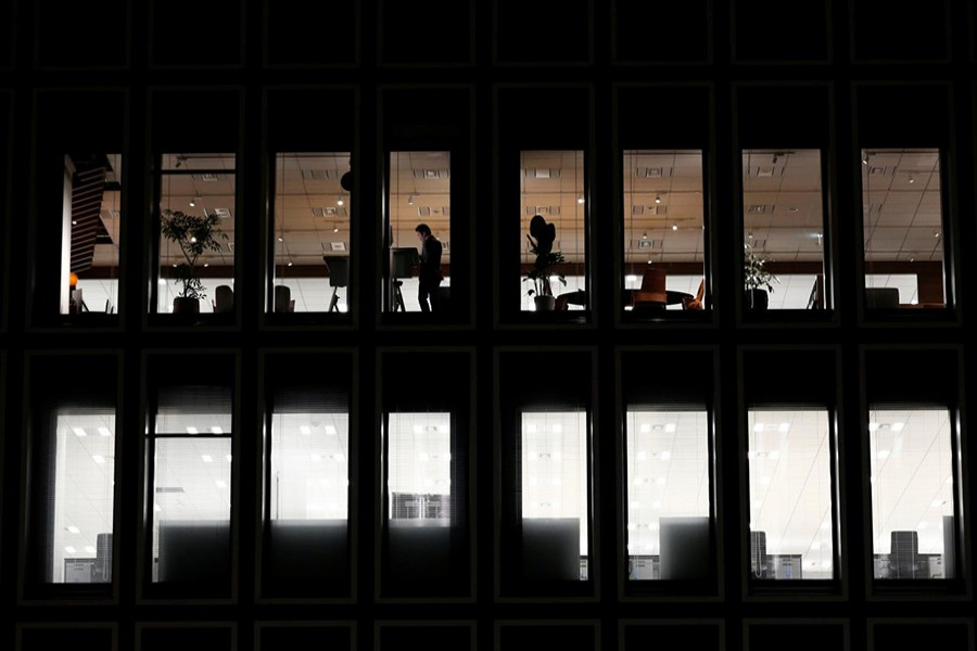 A man is seen at a a commercial building at closing hour at a financial district in Tokyo, Japan on November 22, 2017 — Reuters/File