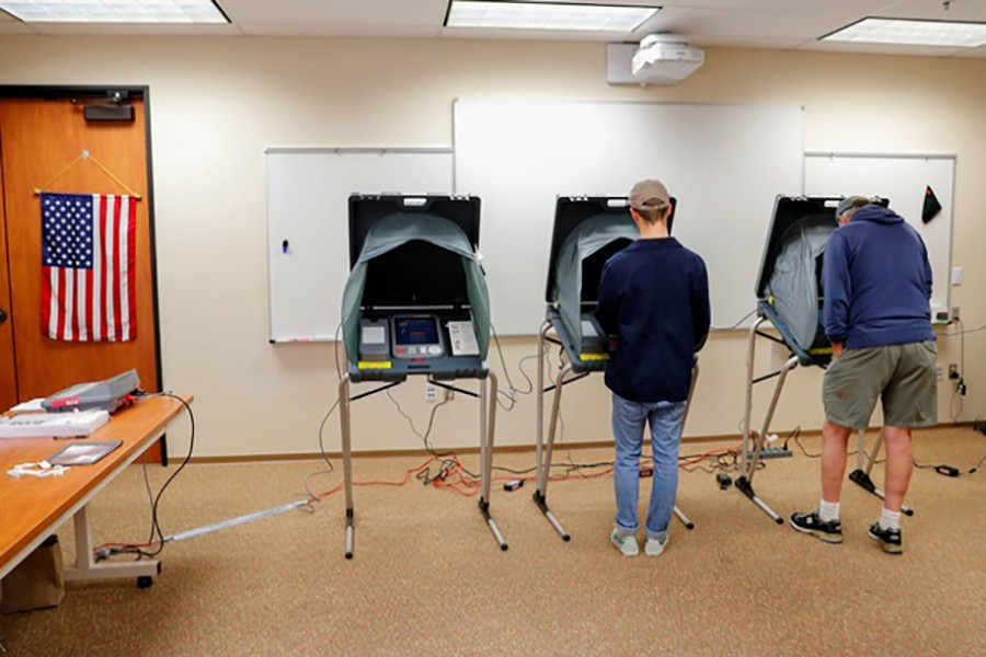 Americans cast their ballots on electronic machines while voting during midterm elections in San Juan Capistrano, California, US November 6, 2018. Reuters