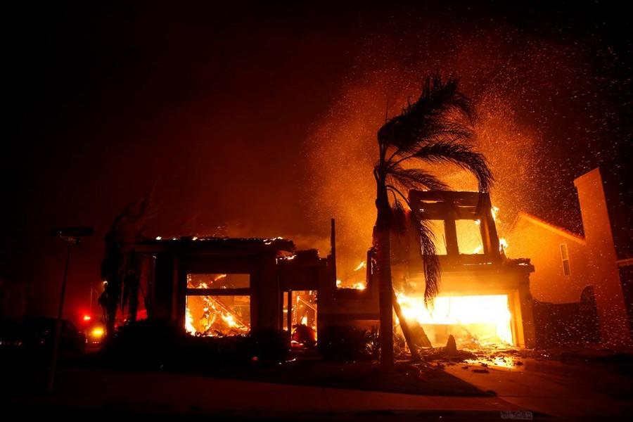 A home burns during a wildfire that claimed dozens of homes in Thousand Oaks, California, US, November 9, 2018 - Reuters/Eric Thayer/File Photo