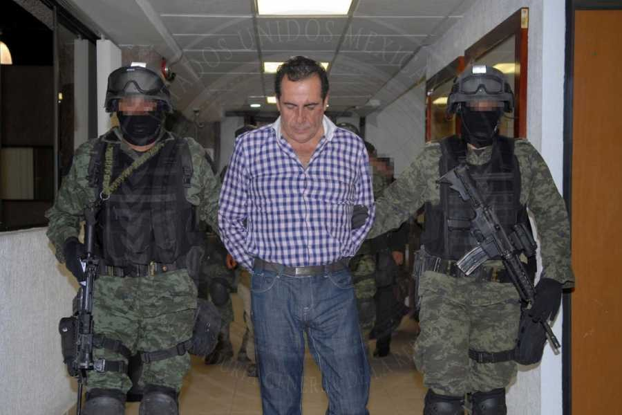 Soldiers escort head of the Beltran Leyva drug cartel Hector Beltran Leyva in Mexico City, in this handout picture taken October 1, 2014 and released to Reuters on October 2, 2014 by the Attorney General's Office - Reuters/Attorney General's Office/Handout