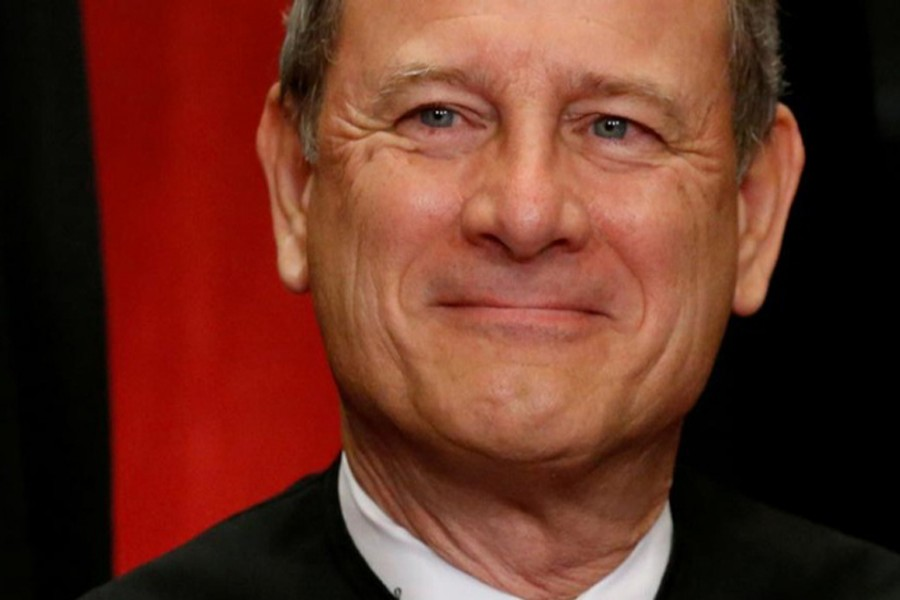 US Chief Justice John Roberts participates in taking a new family photo with his fellow justices at the Supreme Court building in Washington, DC, US, June 1, 2017. Reuters/File Photo