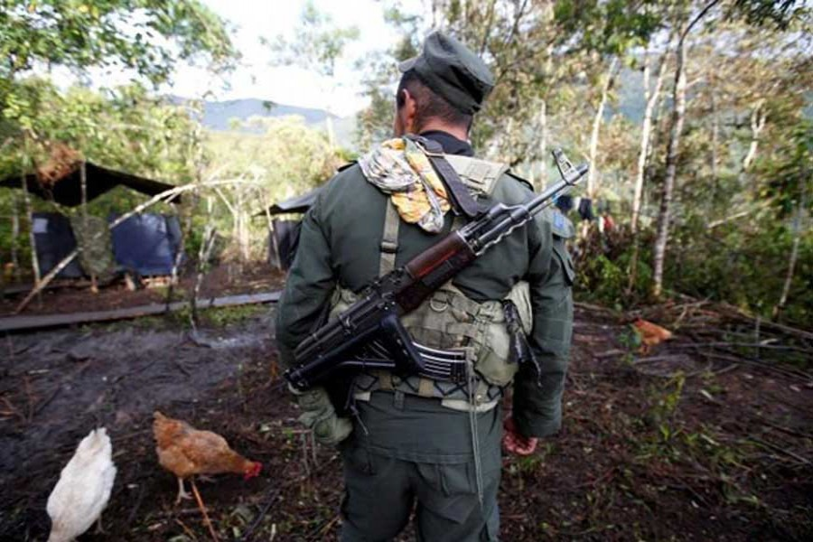 In this Reuters file photo, a member of the 51st Front of the Revolutionary Armed Forces of Colombia (FARC) walks at a camp in Cordillera Oriental, Colombia.