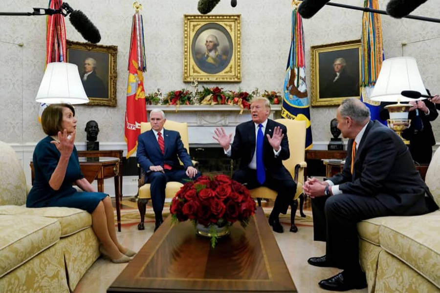 US House Speaker designate Nancy Pelosi (D-CA) speaks with Vice President Mike Pence and US President Donald Trump as they meet with her and Senate Minority Leader Chuck Schumer (D-NY) in the Oval Office at the White House in Washington, US, December 11, 2018. Reuters/File Photo