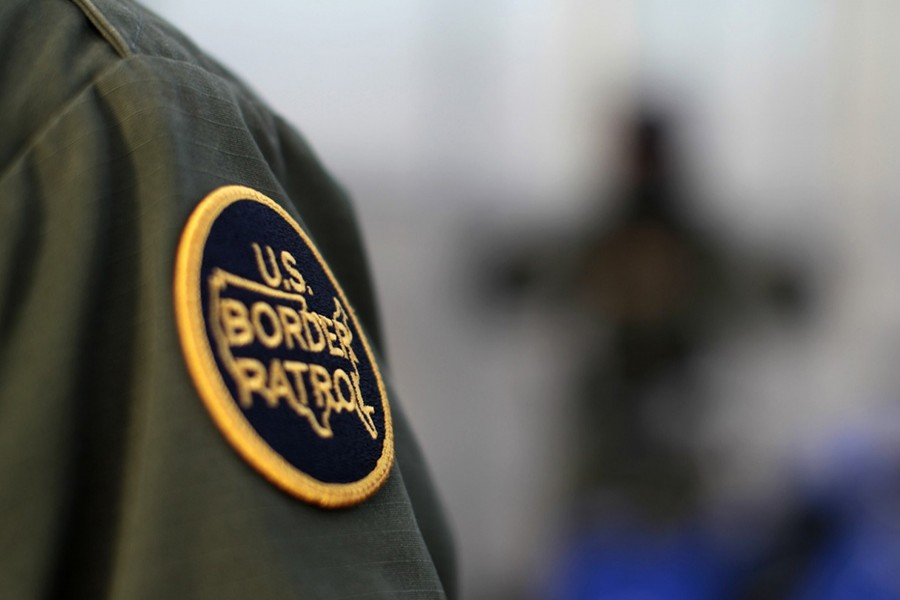 A logo patch is shown on the uniform of a US Border Patrol agent near the international border between Mexico and the United States south of San Diego, California on March 26, 2013 — Reuters/File