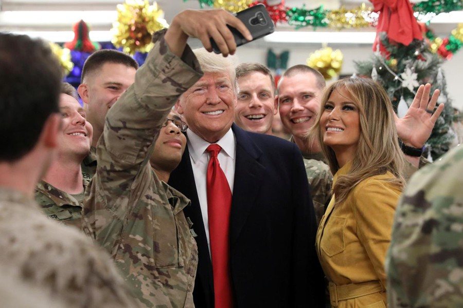 US President Donald Trump and First Lady Melania Trump greet military personnel at the dining facility during an unannounced visit to Al Asad Air Base, Iraq December 26, 2018. Reuters