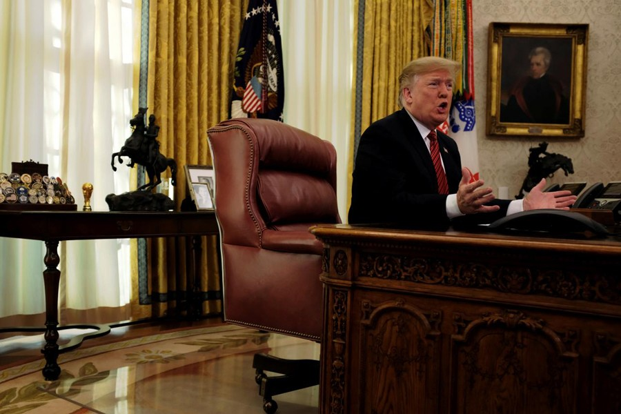 US President Donald Trump speaks with reporters after holding a video call with US military service members in the Oval Office on Christmas morning in Washington, December 25, 2018. Reuters/File Photo