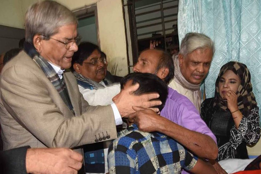 BNP secretary general Mirza Fakhrul Islam Alamgir consoling the family members of Subarnachar gang-rape victim at Noakhali General Hospital on Saturday. Photo: UNB