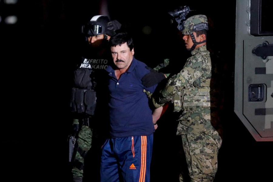 """Joaquin """"El Chapo"""" Guzman is escorted by soldiers during a presentation in Mexico City, January 8, 2016 - REUTERS/Tomas Bravo"""