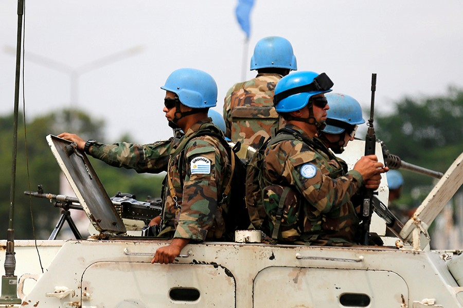Peacekeepers serving in the United Nations Organization Stabilization Mission in the Democratic Republic of the Congo (MONUSCO) patrol in their armored personnel carrier on December 20, 2016 — Reuters/File