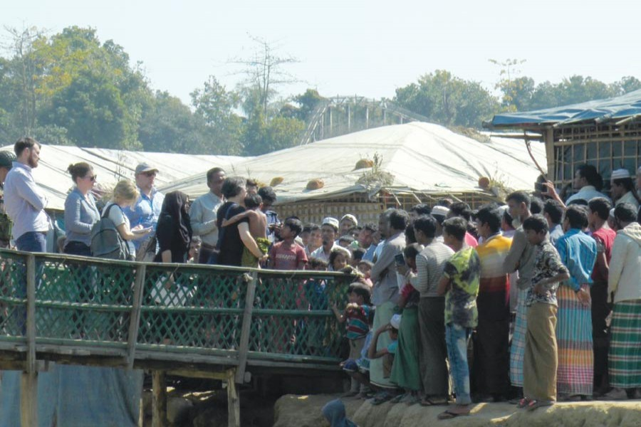Yanghee Lee, the UN Special Rapporteur (at the centre holding a child), visited UNHCR transit centre at Kutupalong of Ukhiya in Cox's Bazar on Sunday, January 21 and talked to Rohingyas staying there. —Photo: UNB