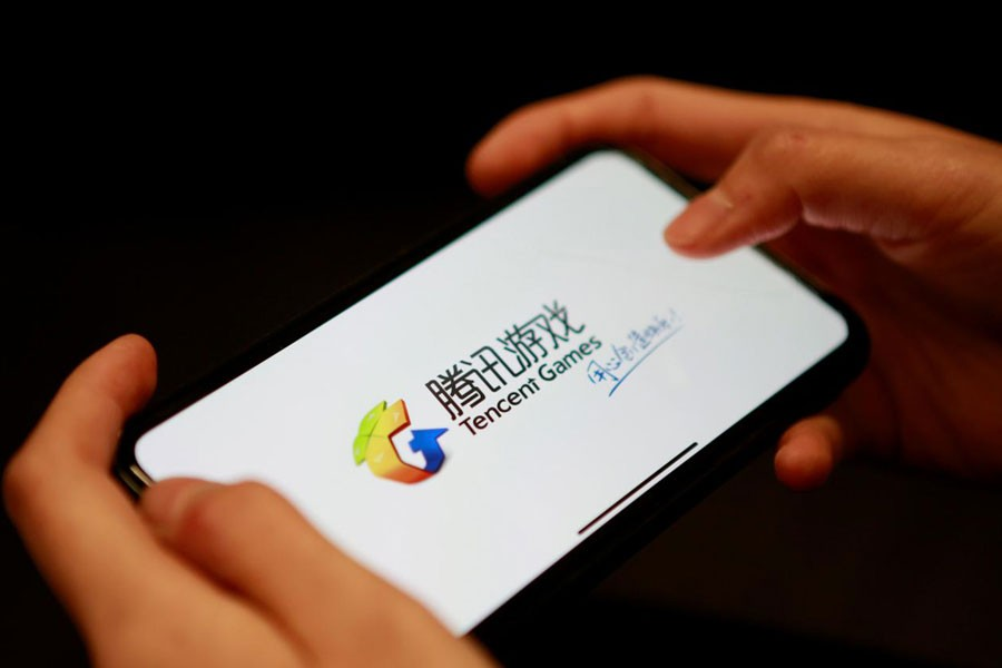 FILE PHOTO: A Tencent Games logo from an app is seen on a mobile phone in this illustration picture taken November 5, 2018 - REUTERS/Florence Lo/Illustration/File Photo